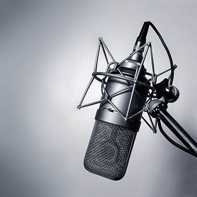 798982 – black and white image of a studio microphone.